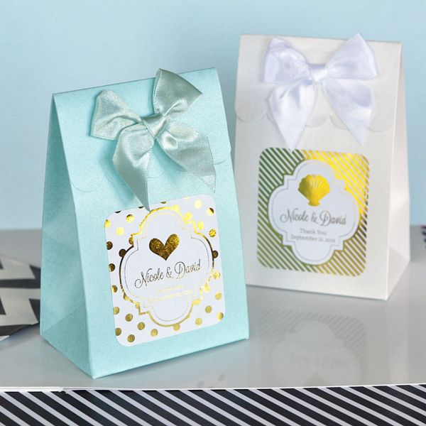 Metallic labels personalized with choice of background pattern, foil color, design, and three lines of print on candy boxes with satin bows