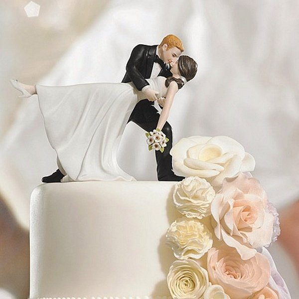Groom dipping bride figurine cake topper