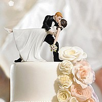 Groom dipping bride cake topper figurine