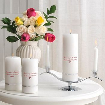 Deluxe white unity candle set shown with metallic silver banded unity candle, silver candle stand, two dripless white taper candles, and two personalized gift candles. Devonshire design shown on unity and gift candles