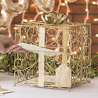 Guest inserting gift card into gold scroll wire gift cards holder