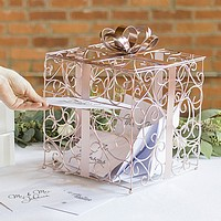 Guest inserting gift card into rose gold scrolled wire gift card box