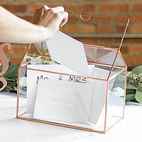 Guest inserting gift card into open top of personalized rose gold trim glass terrarium