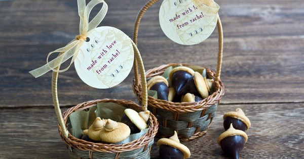 Fall acorn candy favors in miniature basket with personalized tags