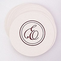 Personalized white round pulpboard coaster printed with Brown imprint, B-12 monogram format, and Edwardian lettering style