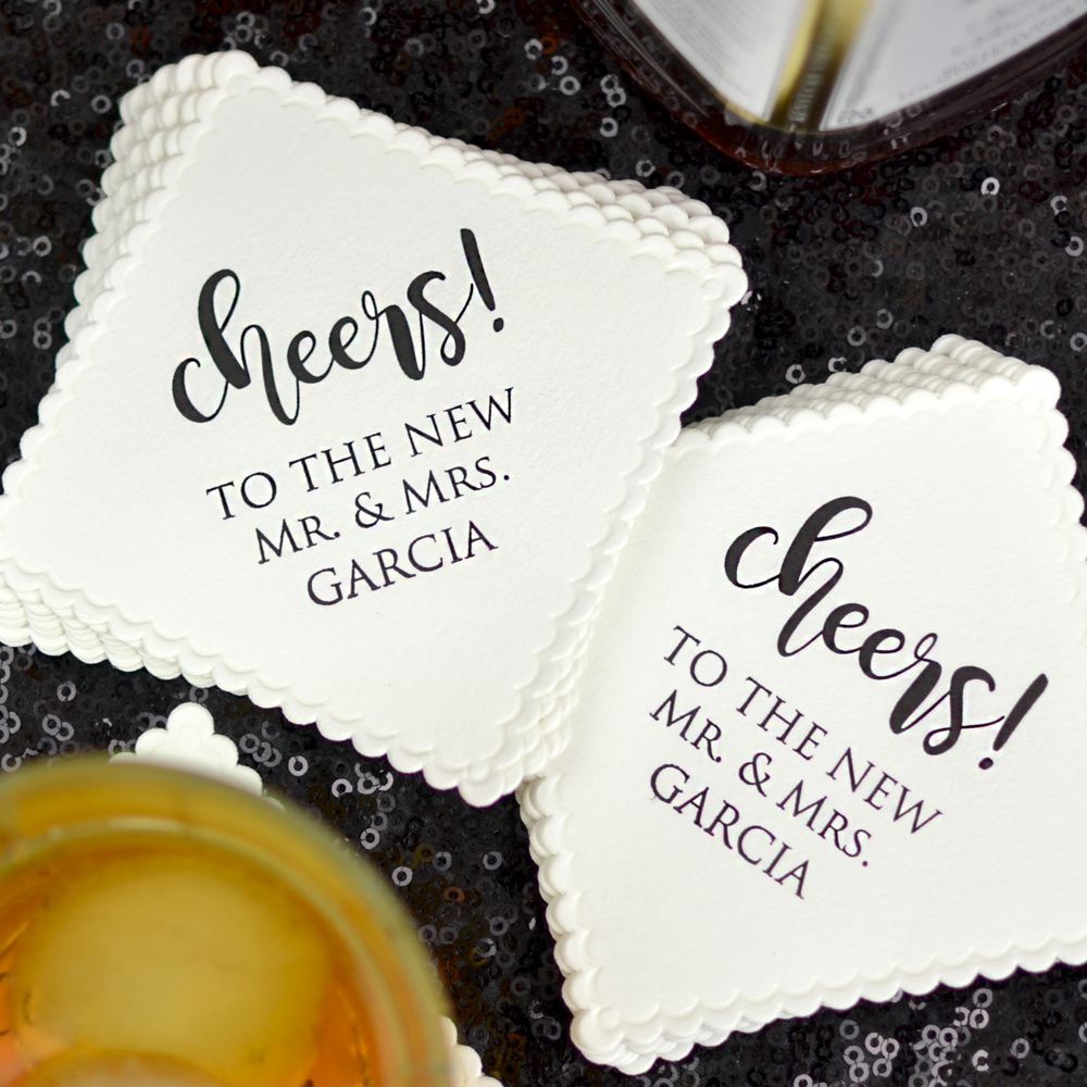Personalized Coasters printed with WCH04 Cheers Bold Script design, Ebony Matte imprint color, and Trajan lettering style