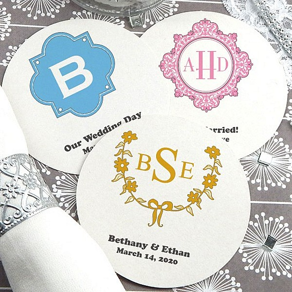 White paper board drink coasters personalized with wedding monogram designs and custom text