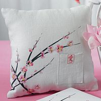 White linen ring pillow with brown and pink cherry blossom branches