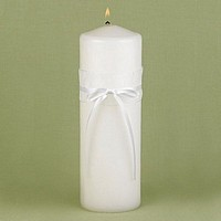 white pillar candle with chiffon ribbon and satin bow