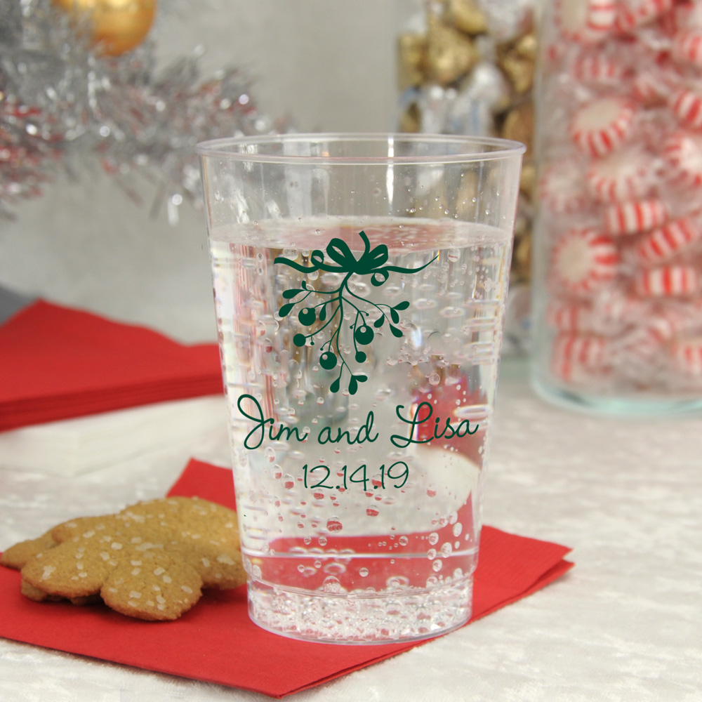 Clear plastic cups printed with forest green imprint, CS1105 design, and two lines of text in Precious lettering style