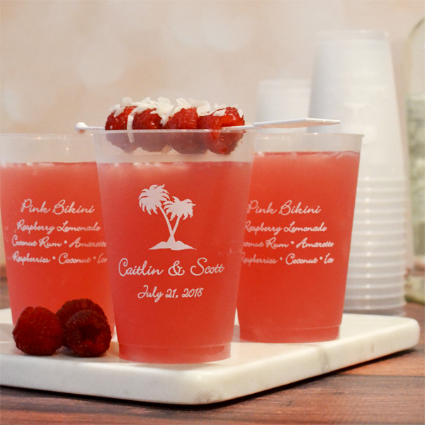 12 ounce personalized frosted plastic cups printed with a design and text on one side, and four lines of text on the other side