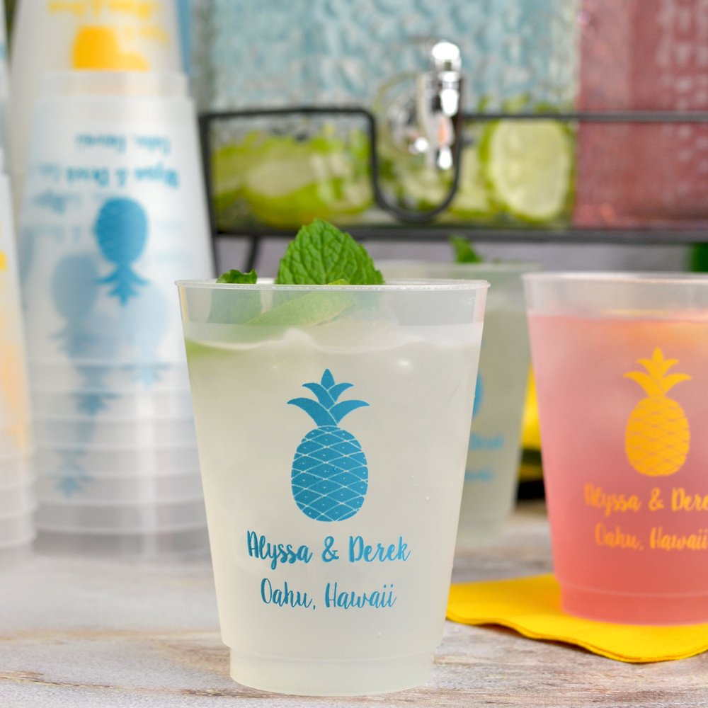 16 Ounce frosted plastic cups custom printed with pineapple design and two lines of custom print in yellow and turquoise print colors