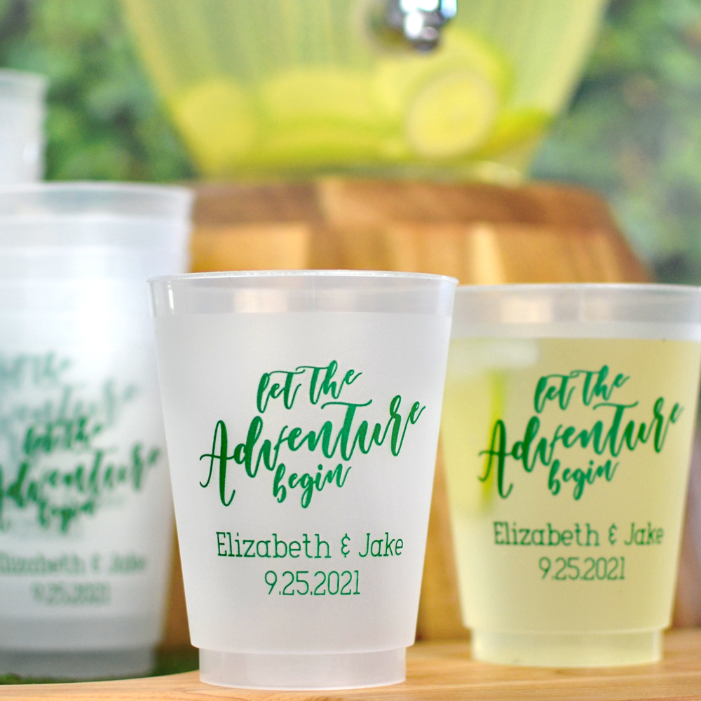 16 Ounce frosted plastic cups custom printed in Forest Green imprint with Let The Adventure Begin design and two lines of text in Adventurous lettering style