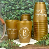 16 Ounce Gold frosted shatterproof wedding cups personalized with Wreath Initial design with block single initial large on the font and two lines of custom print on the back in Ivory Imprint