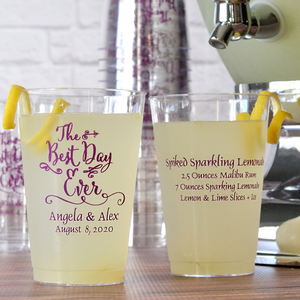 14 ounce clear plastic tumbler printed with eggplant imprint color, BD101 wedding design, and two lines of print on the front and four lines on print on the back in pristine lettering style