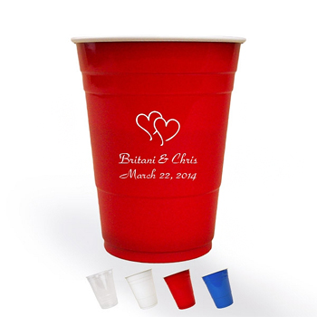 Personalized red plastic solo cups printed in white with 1224 heart design and two lines of text in Park Avenue lettering style