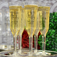 Champagne glasses printed with Let's Party design and two lines of print in Black Imprint