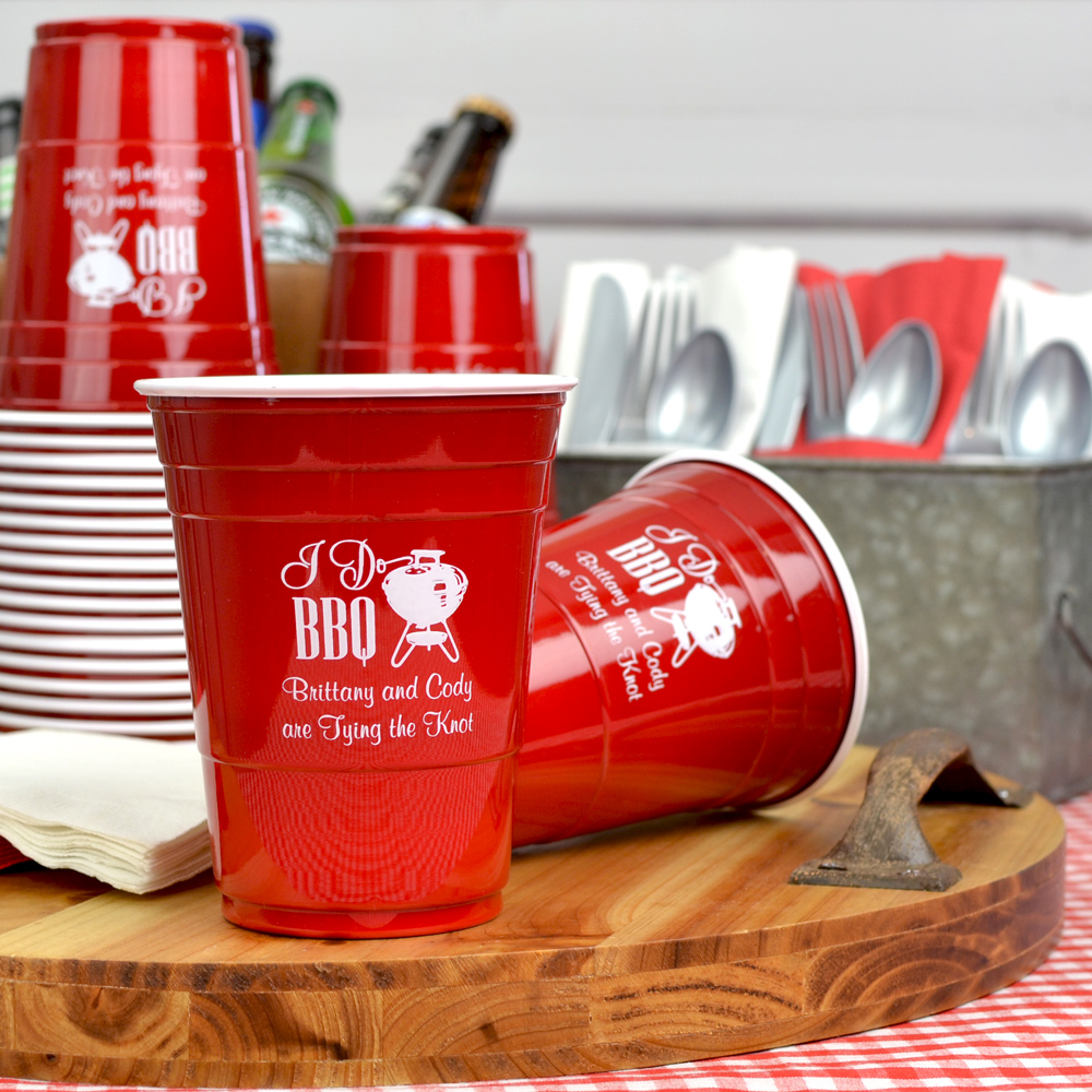 Red soft plastic solo wedding cups printed with ENG06 - I Do BBQ design and two lines of print in Fabulous lettering style, all in white imprint