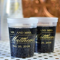 16 Ounce natural clear color plastic stadium cups personalized with M-55 Mr & Mrs monogram design and wedding date in gold imprint color