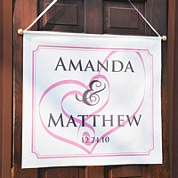 Custom Printed Banner with Embracing Hearts Design and Raspberry Background Color