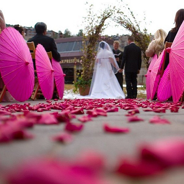 Paper parasols used as wedding aisle decorations