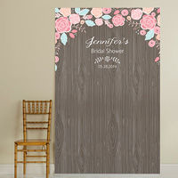 Rustic-chic photo booth backdrop with dark woodgrain background and flourishing floral pattern bordering the top with 3 lines custom text
