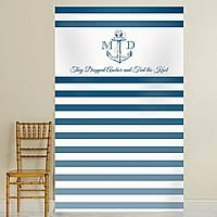 Nautical theme blue stripe photo booth backdrop with bride and groom's initials printed on either side of anchor