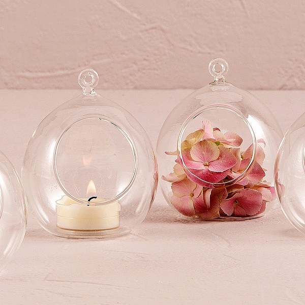 Clear blown glass globes feature an opening large enough for a small candle or flowers to be placed inside
