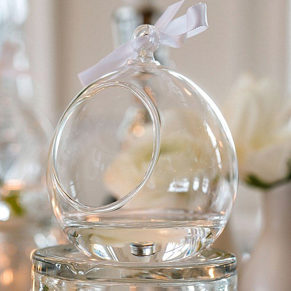 Closeup of round blown glass globes featuring blown glass loop at the top to attach a ribbon or string for hanging
