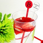 7 1/2 inch plastic stir sticks personalized with your choice if imprint color and lettering style. Available in 6 colors. Shown here in red and crystal clear.
