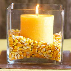 Corn Kernels inside a clear glass candle holder