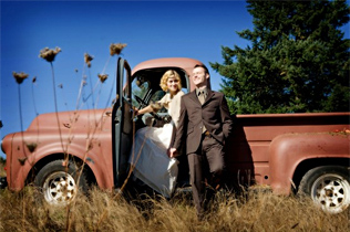 Bride and Groom with Vintage Truck via Kate Kelly Photography