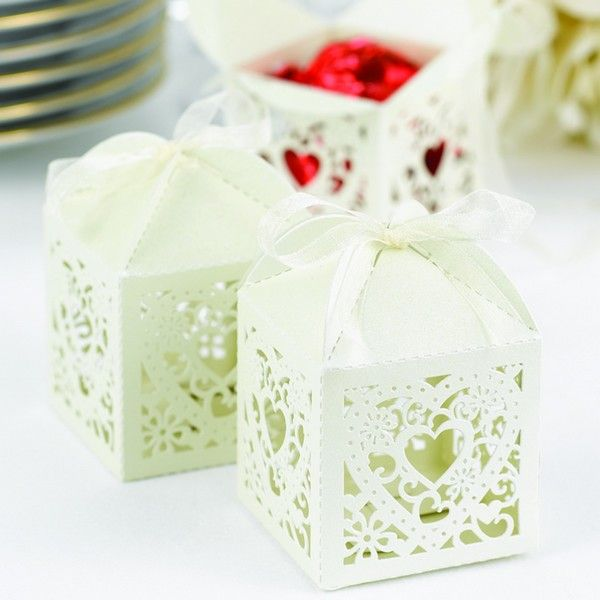 Ivory shimmer favor boxes with ornate die-cut heart design