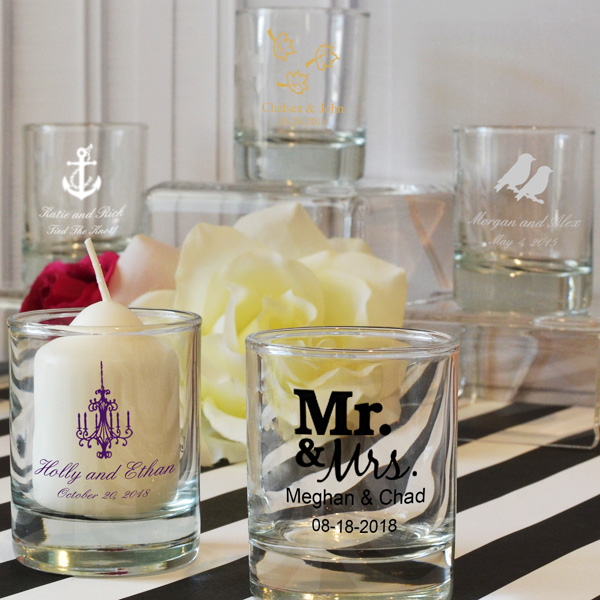 Clear glass votive candle holders personalized with assorted wedding designs, bride and groom names, and wedding date