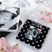 Black glass coasters with white polka dots and centered photo opening
