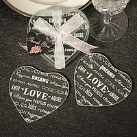 Heart shaped clear glass coasters etched with love words and phrases