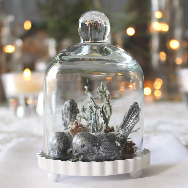 Mini Clear Glass Bell Jar with White Fluted Base houses a winter scene