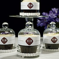 Clear glass bell jars with personalized paper ribbon wraps