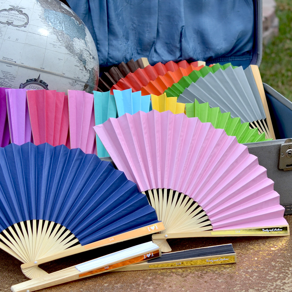 Paper hand fans in assorted colors with custom printed metallic foil labels in Gold and Copper