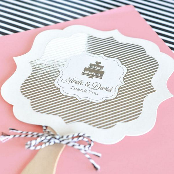 Personalized gold or silver foil stickers on wedding hand fans