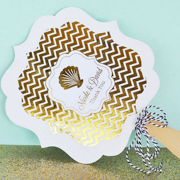 Choose from gold or silver foil labels to affix to white hand fans with wooden paddle