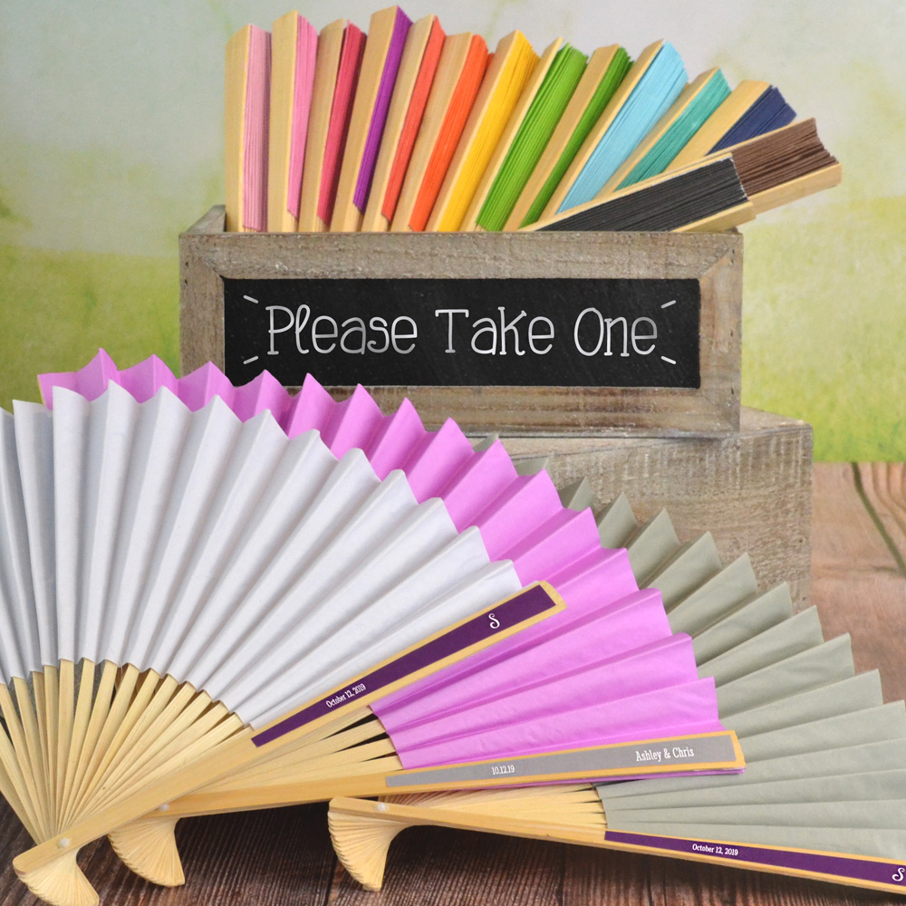 Paper hand fans in assorted colors with custom printed colorful labels