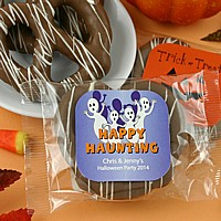 Prepackaged gourmet pretzel favors with personalized Halloween labels