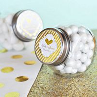 Mini glass candy favor jars with lids featuring personalized metallic labels