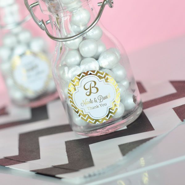 Personalized gold or silver foil stickers on miniature vintage style glass bottles