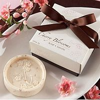 Round, light beige soap embossed with cherry blossoms