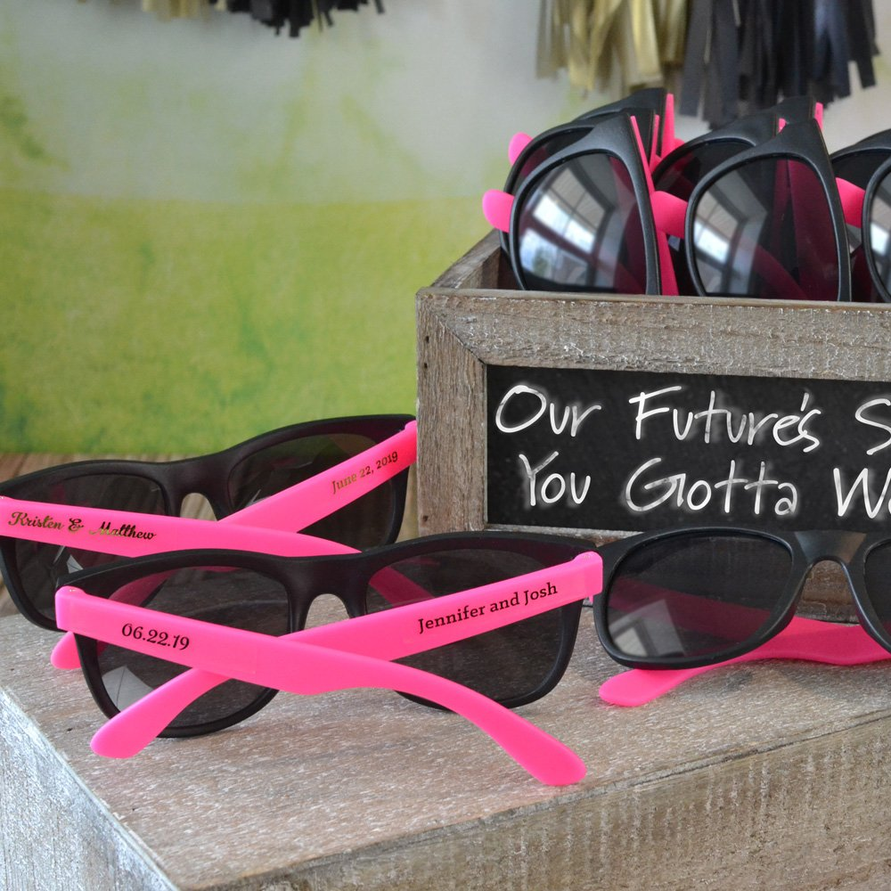 Hot pink and black frame wedding sunglasses personalized with two lines of print on transparent stickers