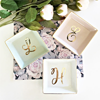 A stylish addition to any women's dresser or bedside table, these pretty monogrammed ceramic ring dishes are perfect for rounding out your bridesmaid gifts and are sure to be loved by each member of your bridal party.