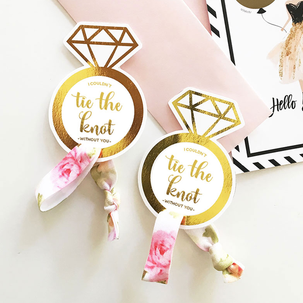 Tie the Knot creaseless hair ties are a fun gift idea to include with your bridesmaids gifts or as favors for the bachelorette party.  Theses durable hair ties look just as cute on your wrist as in your hair and won't leave a crease.