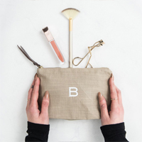 Tan Linen Makeup Bag with personalized initial M embroidered in White Thread.